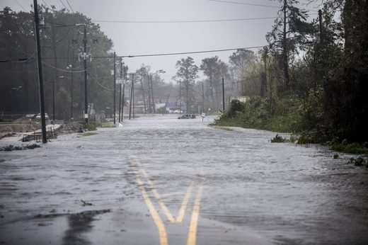 A street sits submerged in flood water n Wilmington, North Carolina