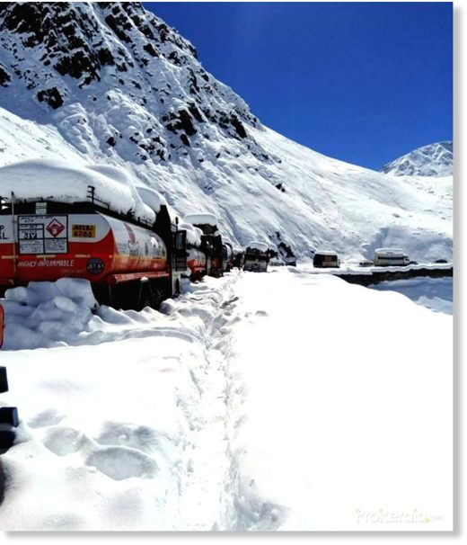 Vehicles stranded at Bara-lacha la due to heavy snowfall, some 80 km away from Keylongin Lahaul and Spiti district of Himachal Pradesh