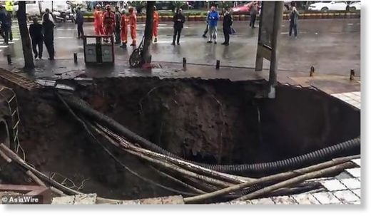 Two people were killed in south-west China's Sichuan province after a massive sinkhole swallowed four pedestrians on Sunday afternoon. Two others remained missing