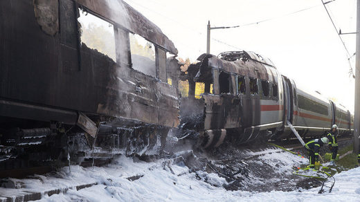 Firefighters work on a Deutsche Bahn Inter City Express (ICE) train that caught fire on October 12, 2018 near Montabaur Germany