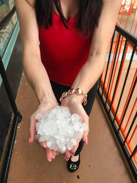 A Gympie resident with handfuls of hail