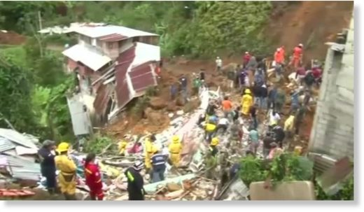 An overnight landslide caused by heavy rains leaves 11 people including four children dead in a central Colombian town