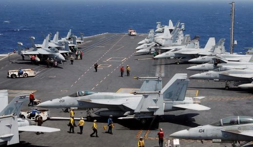 The only fixed wing aircraft that operate from U.S. Navy aircraft carrier, F/A-18 Hornet, F/A-18E Super Hornet, E-2C and E2-D Hawkeye AEW&C aircraft.