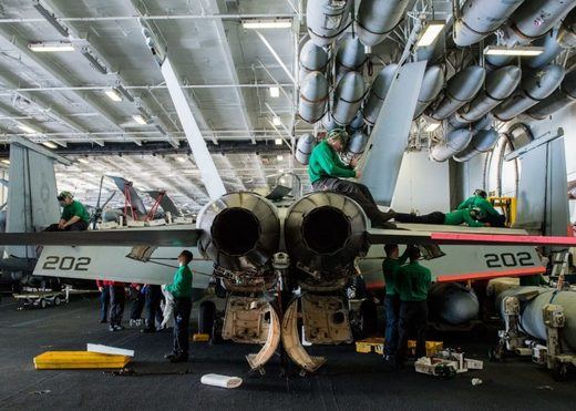 Maintenance crews performing repairs F/A-18