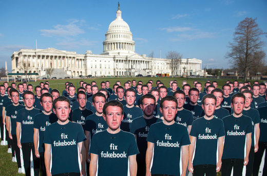 Cardboard cutouts of Mark Zuckerberg
