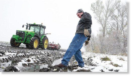Rain and early season record snowfall delay North Dakota ...