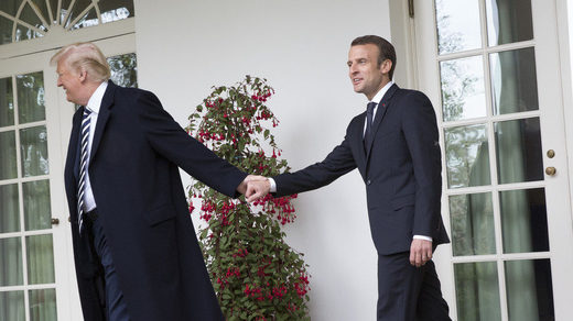 Trump and Macron holding hands