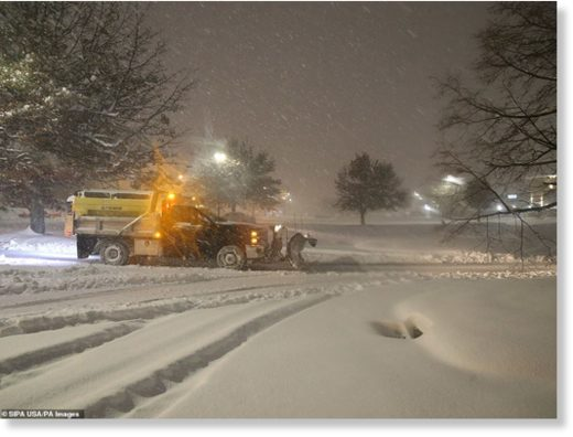 A plow clears a parking lot at the Hudson Valley Towne Center parking lot in Fishkill
