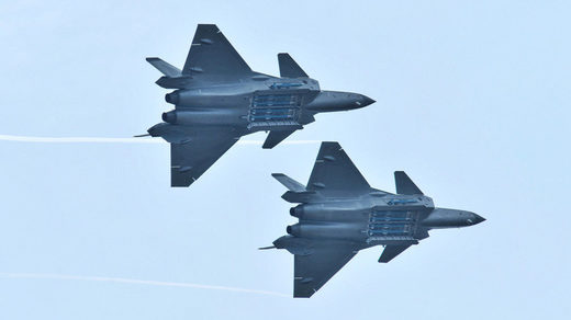 Chengdu J-20 stealth fighter jets with open weapon bays during the Zhuhai Airshow