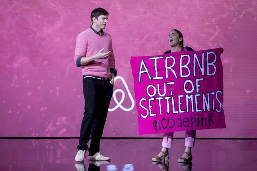 Ariel Gold disrupts Ashton Kutcher's Airbnb presentation.