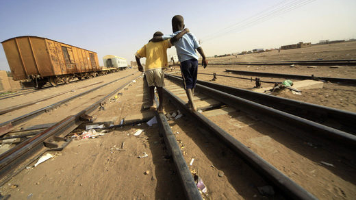 South Sudanese children wait at a train station in Khartoum