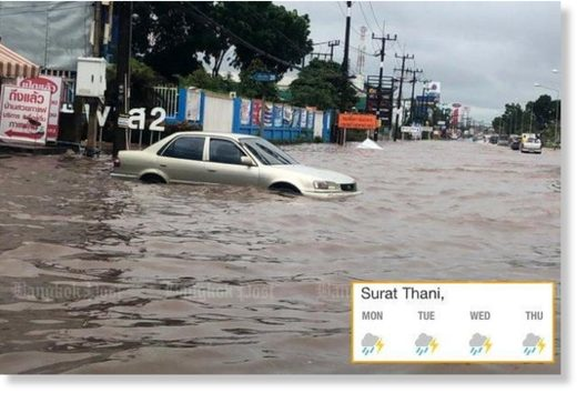 Vehicles crawl through a flooded road in Surat