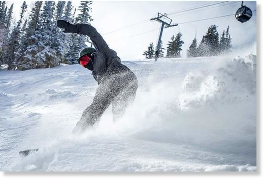 Chicago resident Cooper Bluhm, 18, slashes through some powder on Bell on Aspen Mountain on Friday morning.