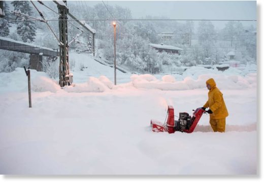 A man uses a snow blower to free a platform at the station in Berchtesgaden, Bavaria, Germany. Austria