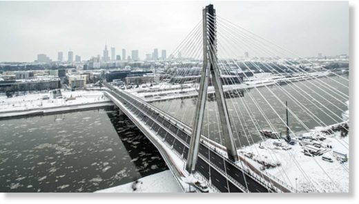 Aerial picture taken by a drone shows a snowy panorama of Warsaw and the Vistula River with Swietokrzyski Bridge in Poland