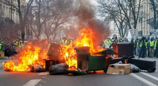 yellow vests burning barricade