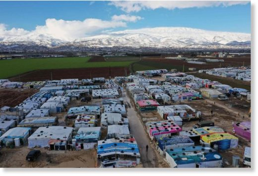 An aerial view shows an informal tent settlement housing Syrian refugees in the area of Delhamiyeh, in the central Bekaa Valley.