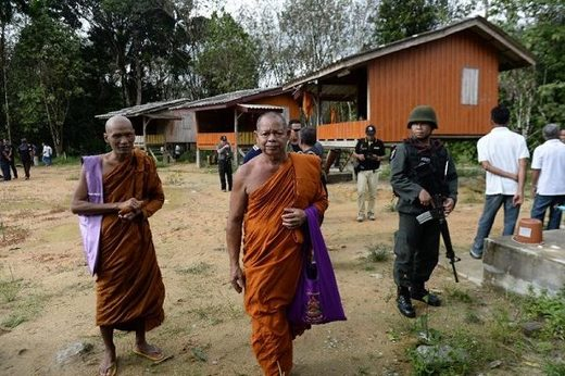 Buddhist monks and armed Thai police