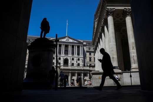 A pedestrian passes the Bank of England in the City of London.