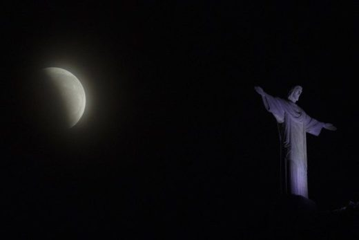 A blood moon rises above the Christ the Redeemer statue during a lunar eclipse in Rio de Janeiro, Brazil