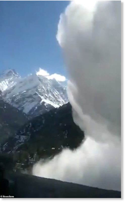 Mountain scenes covered by a massive cloud of powdery snow as the avalanche takes hold