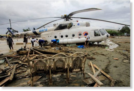 Flash floods in Sentani, Papua, Indonesia, left debris and mud around a helicopter on Sunday.