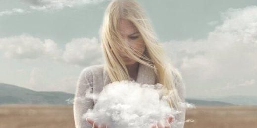 blonde woman holding cloud