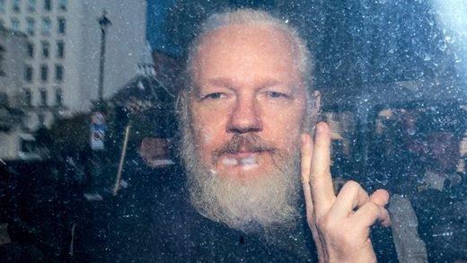 1Julian_Assange_gestures_to_th.jpg