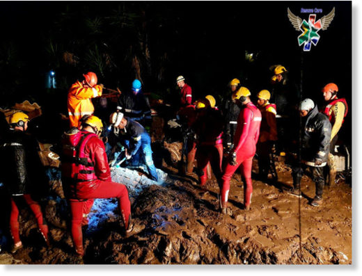 Rescue workers on the scene of a mud slide