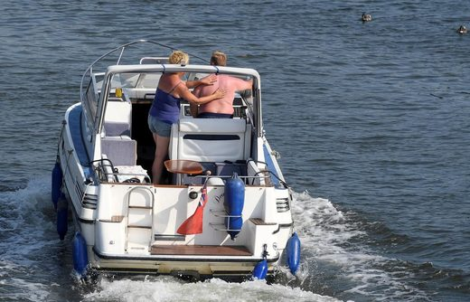 sunscreen boat couple