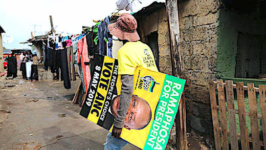 Man carries ANC poster