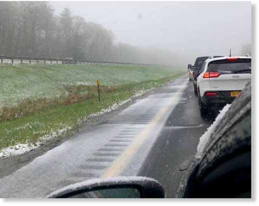 Winterlike weather made a snow scene for motorists on the turnpike Sunday in Blandford, Massachusetts.