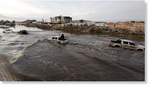 Vehicles drive through a flooded road following heavy rains in Sanaa, Yemen.