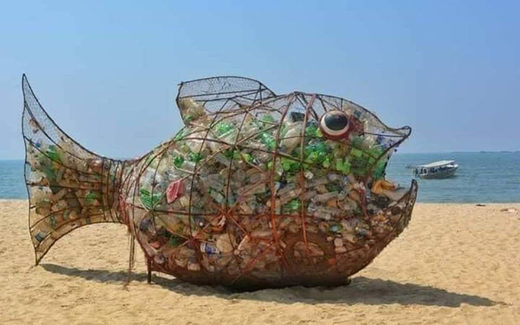 fish sculpture beach trash