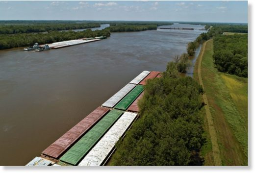 Barges sit along the shores of the Mississippi River