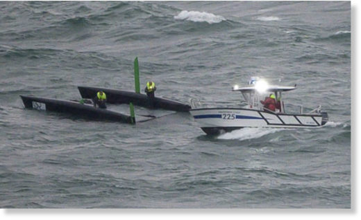 A police speedboat rescues a boat capsized after a massive storm during the Bol d'Or sailing race on Lake Geneva.