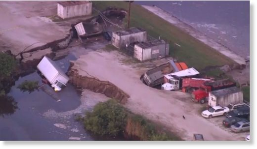 Several trucks ended up in a possible sinkhole near Orlando International Airport early Wednesday.