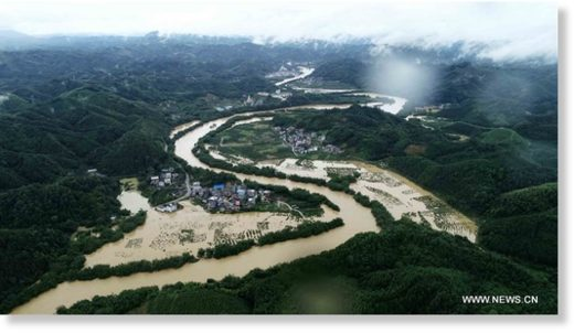 Aerial photo taken on July 9, 2019 shows the flooded areas in Dajiang Town, Rong'an County, south China's Guangxi Zhuang Autonomous Region.