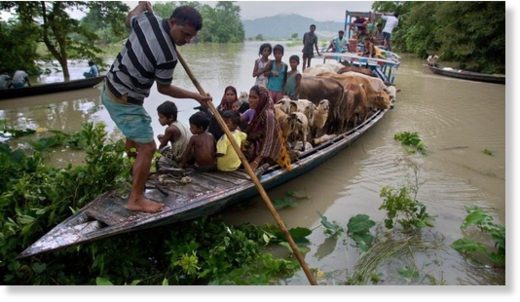 Flood affected villagers with their belongings