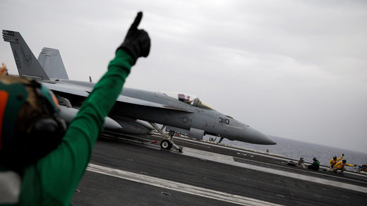 An F/A-18 fighter jet prepares to take off from the USS Harry S. Truman aircraft carrier