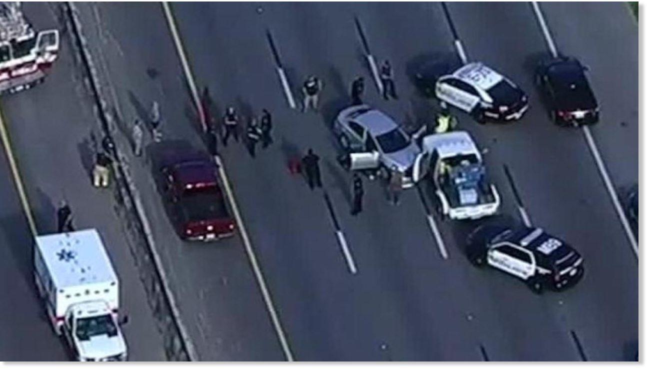 Unreal scene': Manhunt starts for gunman who kills 2 after crash on