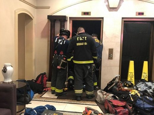 New York Fire Department members investigate an incident with an elevator in an apartment building