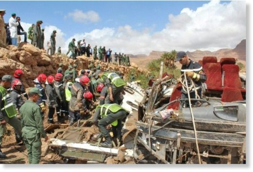 Security forces search the wreckage of a flood-related bus accident in southern Morocco on September 8, 2019