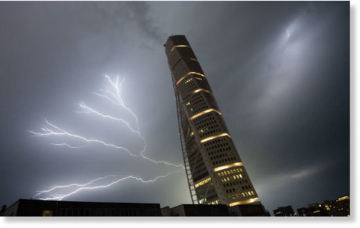 Lightning strikes behind Malmö's Turning Torso tower.