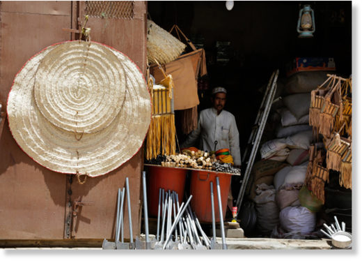 A Yemeni vendor sells coffee and in the old market in Najran, Saudi Arabia.