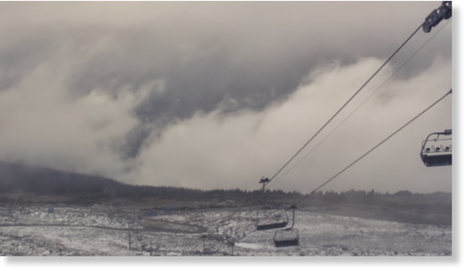 A still image from web cam video shows snow on Whistler Blackcomb's 7th Heaven summit.