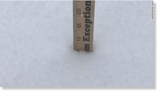 Carlene Whitney Salois took pictures of a ruler in the snow during a storm in Montana.