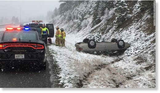 Montana Highway Patrol Trooper Amanda Villa caught this image of a car flipped over in harsh weather in Montana.