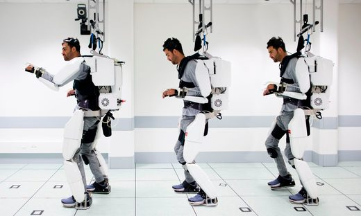 paralyzed man walking with exoskeleton