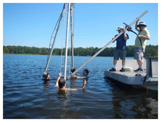 Collecting sediment cores from White Pond